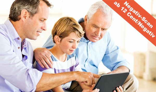 Grandson With Father And Grandfather Using Digital Tablet At Hom